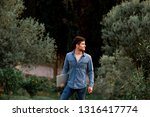 man in jeans suit standing with ...   Shutterstock . vector #1316417774