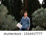 man smiling in jeans suit...   Shutterstock . vector #1316417777