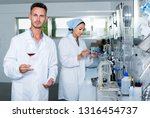 attentive glad man testing wine ... | Shutterstock . vector #1316454737