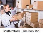 woman worker standing with...   Shutterstock . vector #1316509154