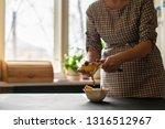 housekeeper peel potatoes with...   Shutterstock . vector #1316512967