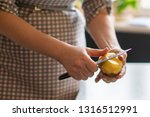 housekeeper peel potatoes with...   Shutterstock . vector #1316512991