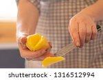 housekeeper peel potatoes with...   Shutterstock . vector #1316512994