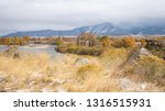 Small photo of The Beaverhead River and Blacktail Mountains in Montana in the autumn beneath blustery skies.
