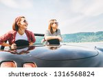 two females friends traveling... | Shutterstock . vector #1316568824