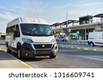 Small photo of Antalya / Turkey - 09.27.18: Airport shuttle Fiat Ducato on background monorail station