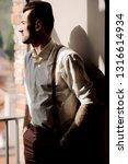 attractive brunette man in...   Shutterstock . vector #1316614934