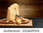 parmesan cheese on wooden board   Shutterstock . vector #1316639141