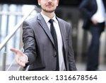confident businessman holding... | Shutterstock . vector #1316678564