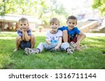 three happy young boys in... | Shutterstock . vector #1316711144