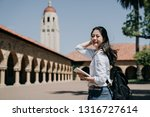 Stock photo asian college girl standing outdoor going to class at school in summer tour program elegant smart 1316727614