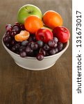 Bowl With Fruits  On Wooden...