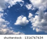 beautiful blue sky and white... | Shutterstock . vector #1316767634