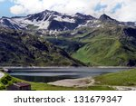 View from Lukmanierpass on the St. Mary Lake in Graub�¼nden, Switzerland, the lake is surrounded by mountains over 3,000 meters/Dam lake at Lukmanierpass in Graub�¼nden, Switzerland