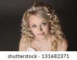 Portrait of a beautiful young woman dressed as a bride. - stock photo