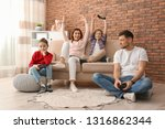 happy family playing video... | Shutterstock . vector #1316862344