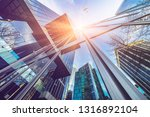 jet plane flying over downtown...   Shutterstock . vector #1316892104