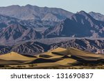 Sand Dunes And Mountains At...