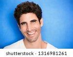 smiling guy on blue background  ... | Shutterstock . vector #1316981261