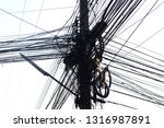 messy electrical cables and... | Shutterstock . vector #1316987891