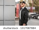 male security guard outdoors | Shutterstock . vector #1317087884