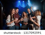Stock photo girl is too shy to dance beautiful youth have party together with alcohol in the nightclub 1317092591