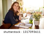 portrait of a smiling mature... | Shutterstock . vector #1317093611