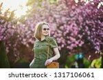 beautiful french woman walking...   Shutterstock . vector #1317106061