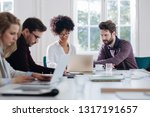 young business people typing on ... | Shutterstock . vector #1317191657