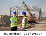 two engineers shaking hand on... | Shutterstock . vector #1317195377