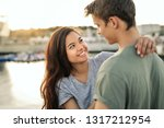 smiling young couple looking at ... | Shutterstock . vector #1317212954
