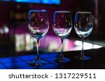 empty wine glasses in row on... | Shutterstock . vector #1317229511
