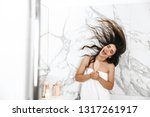 beautiful young woman wrapped... | Shutterstock . vector #1317261917