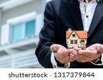 home buying and selling agents.... | Shutterstock . vector #1317379844