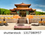 """The temple, where the jade-golden statue of the goddess Guanyin is  in the Nanshan park. Above the entrance is a sign saying: """"The Golden Goddess of Guanyin». Hainan"""