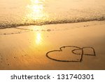 Hearts Drawn On The Sand Of A...
