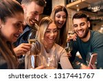 group of young friends having... | Shutterstock . vector #1317441767
