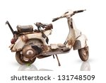 The Old  Rusty Motorcycle Is...