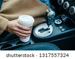 woman hand taking cup with... | Shutterstock . vector #1317557324