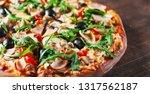 pizza with mozzarella cheese ... | Shutterstock . vector #1317562187