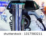 electric car charger. plug car. | Shutterstock . vector #1317583211