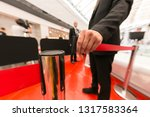 Stock photo security hand fastens a red tape closing the passage 1317583364