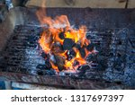 stove charcoal.orange flames of ... | Shutterstock . vector #1317697397