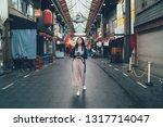 full length happy female... | Shutterstock . vector #1317714047