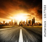 Motion blurred road heading into the city - stock photo