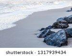 stones on the sandy seashore....   Shutterstock . vector #1317939434