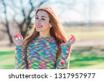 spring time concept. redhead... | Shutterstock . vector #1317957977
