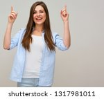 smiling woman pointing up with... | Shutterstock . vector #1317981011