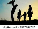 silhouette of a happy family...   Shutterstock . vector #1317984767