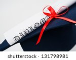 Graduation hat and Diploma - stock photo